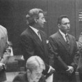 Flores was (Left to right) Officer Paul Harper, his lawyer Joel lsaacson, Sgt. Edward Ortiz, Sgt. Brian Liddy