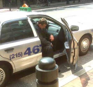 Chris Wright settles into a taxicab shortly after his sentencing on corruption charges.