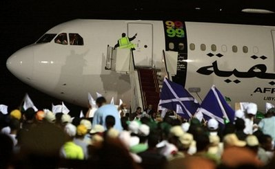 The aeroplane carrying Libyan Abdel Baset al-Megrahi arrives at the airport in Tripoli, Libya, Thursday, Aug. 20, 2009. The only man convicted in the bombing of Pan Am Flight 103 returned home to Libya to die after he was released from a Scottish prison Thursday, a decision that outraged some relatives of the 270 people killed when the jetliner blew up over Lockerbie, Scotland, more than two decades ago.