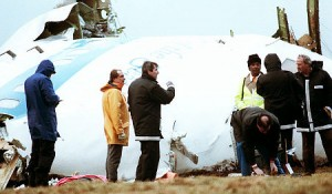 Crash investigators inspect the nose section of the crashed Pan Am flight 103 near Lockerbie, Scotland, on December 23, 1988.