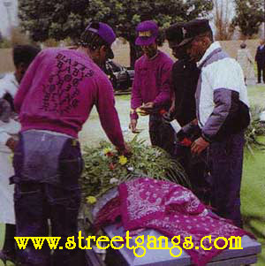 Grape Street Crips from Watts Los Angeles during a funeral. Photo from Newsweek Magazine March 28, 1988 page 28