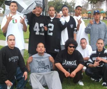 27 arrested in raid of los angeles gang lennox 13