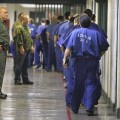 Inmates are watched by members of the Los Angeles County Sheriff's Department at the Men's Central Jail in Los Angeles