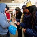 Paul Washington (center) Andre Jackson (second from right) and Robert Price Jr. (right) make a sale.