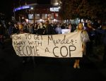 Protesters march through uptown Charlotte, North Carolina November 30, 2016, following the decision of the district attorney not to press criminal charges against police in the shooting of Keith Scott. REUTERS/Jason Miczek